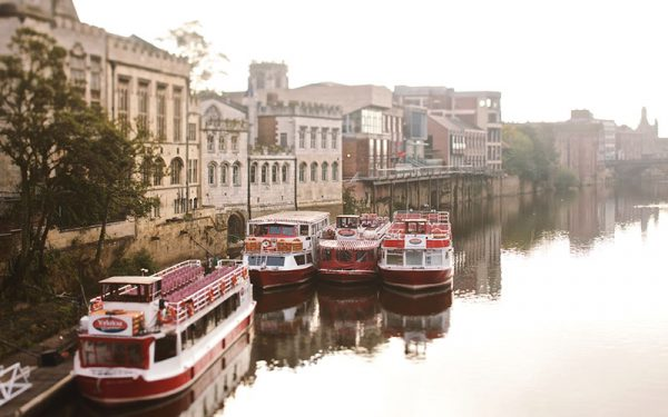 Boats docked on River Ouse in York