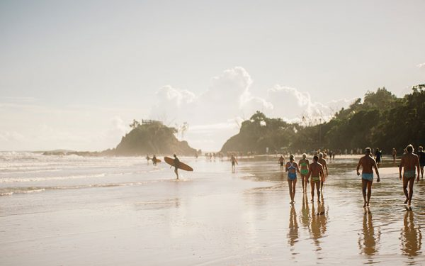 Surfers and beachgoers in Byron Bay