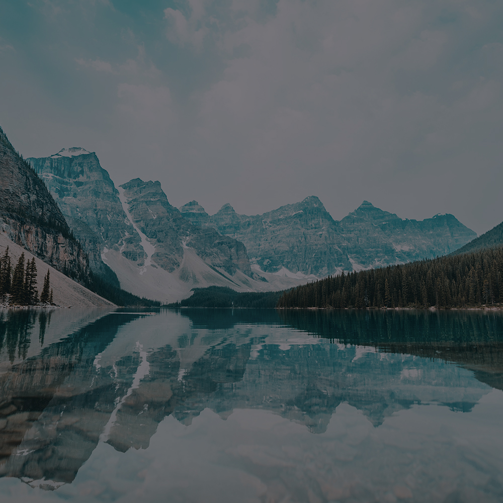 Lake with mountains reflecting in the water
