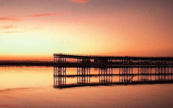 Sunset at a pier in Huelva