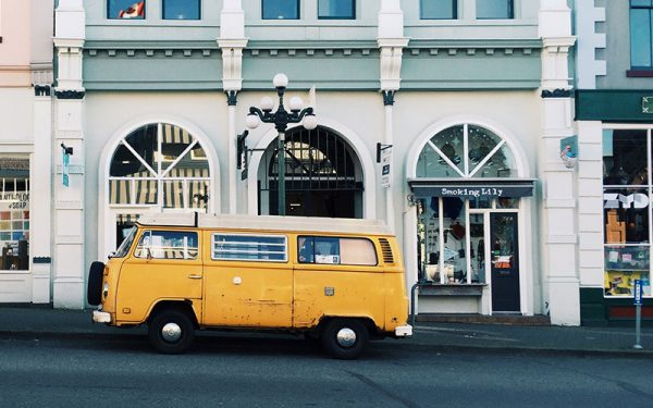 Yellow campervan parked on the side of the road