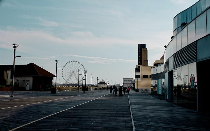 Ferris Wheel and people walking in Atlantic City