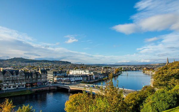 A river flowing through Inverness with a bridge going over it