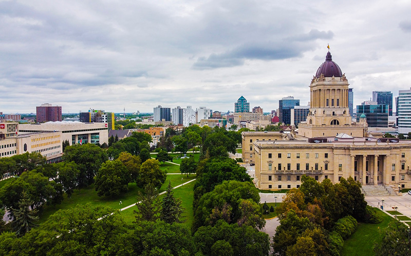landscape of winnipeg city with trees and buildings